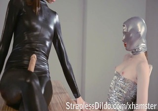 female-dom in shiny catsuit gives shlong